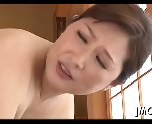 Beautiful asian older plays with water on her delicious pussy